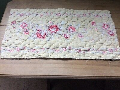 Pretty vintage quilt peice roses on a lemon  background with small flower edges.