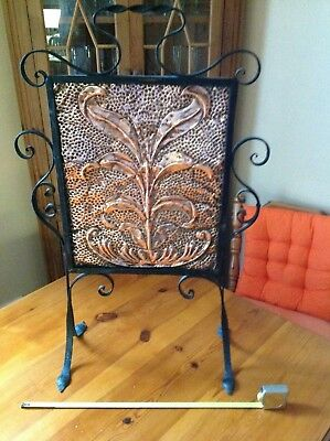 wrought iron and copper fire screen
