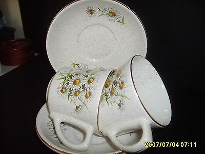 kernewek pottery ,cornwall  pair of  antique cup and saucer in the daisy design