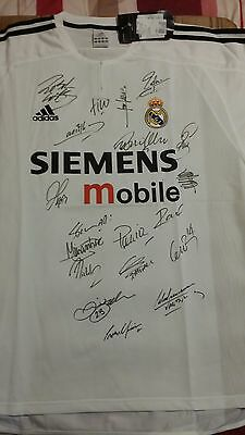 Real Madrid home shirt 2003-2004 signed by 19. Short sleeved, tagged & adult XL.