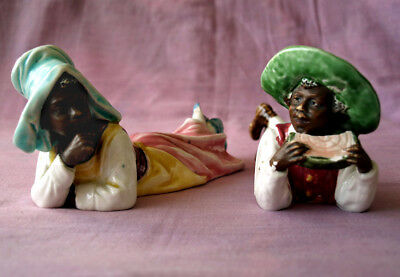 Good pair of early 20thC ceramic Negro boy and girl.