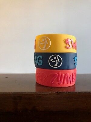 12 Authentic Original Zumba bracelets, several colors and styles