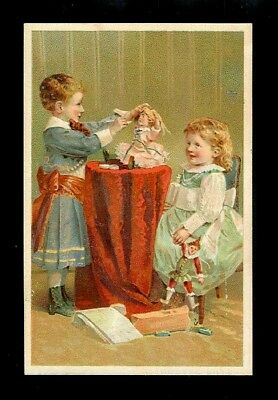 """Girls Play """"Doctor"""" With Their Doll-1880s Victorian Trade Card"""