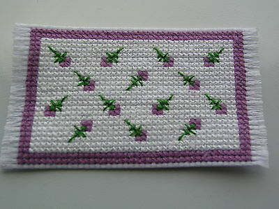 Dolls house rug cross stitch handmade purple flowers on white background