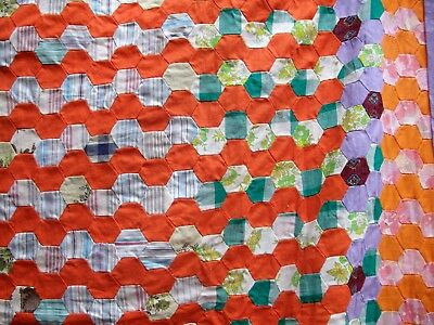 Vintage hand sewn quilt top; small cotton hexagons, orange furrows. Estate find.