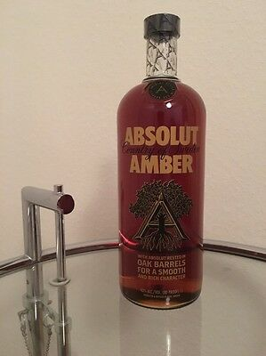 Absolut Vodka Amber 1000 ml full and sealed with rare sticker on the back