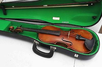 old violin bow and modern case