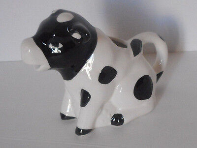 Adorable! black and white cow creamer