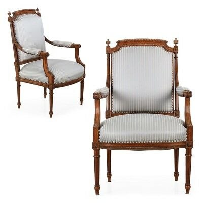 Pair of Finely Carved Walnut Antique French Arm Chairs in the Louis XVI taste
