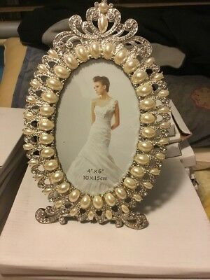 """Silver and pearl oval photo frame with stand.  4"""" x 6"""" Still in original box"""