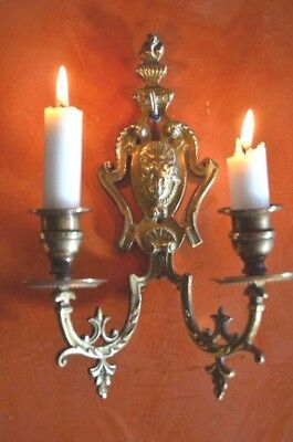 A pair of antique French solid bronze 2 armed wall sconces/candle holders