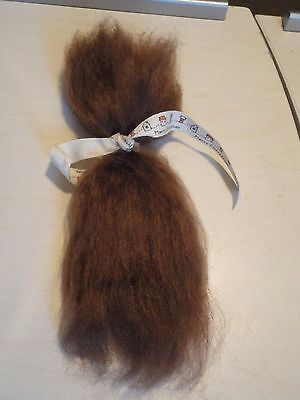 Brown  mohair    root your babies hair