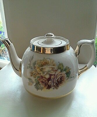 Antique Teapot With Gold Gilding