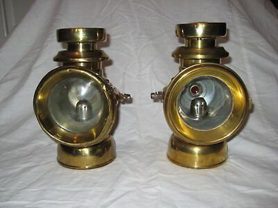 1 pair of Lucas Kings Own brass lamps nos. F143 & F144