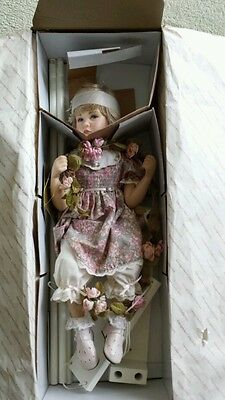 Porcelain doll. Jessica on swing. By Georgetown collection. Brand new.