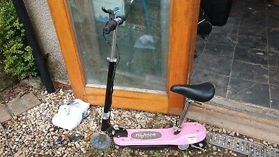 pink electric scooter with seat