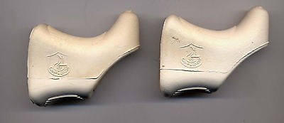 Second choice Pair of white (yellowed) Campagnolo Shield Logo Brake Lever Hoods