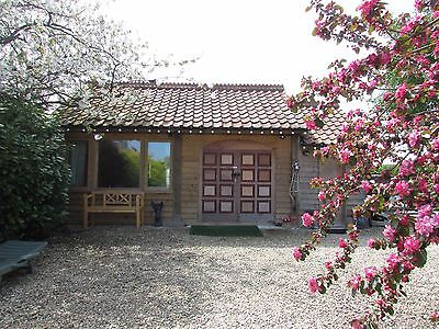 Glastonbury area - log cabin with hot tub- self-catering accommodation