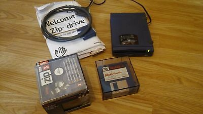 IOMEGA ZIP 100 DRIVE AND 7 New sealed DISCS. IN VERY GOOD CONDITION