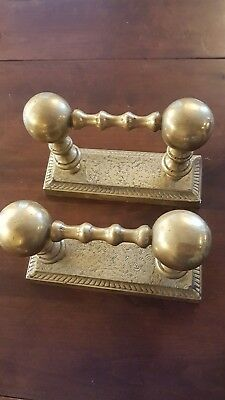 Vintage brass fire dogs and iron companion set stand