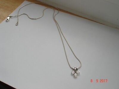 Sterling silver pendant and chain with three drop pieces with clear stones