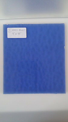 """Blue stained glass 1 sheet 9""""X 8"""" X 1/8"""" with a rippled surface."""