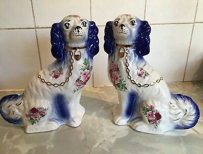 A Pair Of Antique Staffordshire King Charles Spaniels
