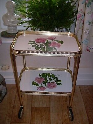 Sweetest vintage 2 tier tea trolley on wheels with pink roses & green foliage.