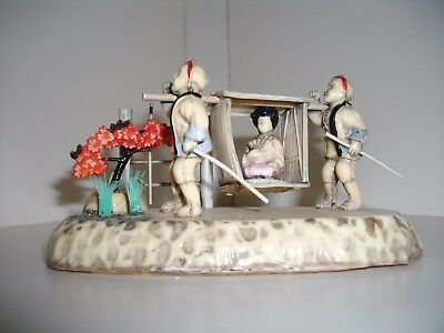 Japanese Celluloid Figure Group of lady in a sedan chair c1920's