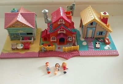 Three polly pocket houses and figures