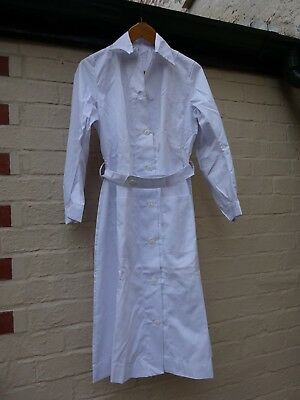 Vintage women's white lab/ doctors coat with belt never worn.