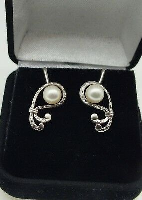 Vintage sterling silver signed Mikimoto Pearl screw earrings.