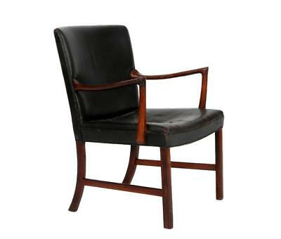 A rosewood armchair upholstered in black leather by Ole Wanscher