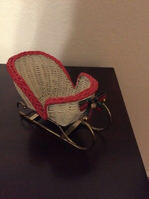 DECORATIVE WHITE WICKER SLEIGH WITH GOLDTONE RUNNERS & Red TRIM