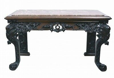 Library table- rose marble top on heavily carved base with mahogany a... Lot 681