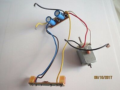 scalextric model car, motor, circuit board and lights