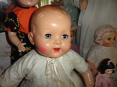 composition doll w/ hard plastic head  27 w/antique slip ,vintage baby doll