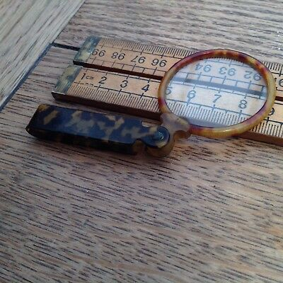 A Vintage Folding Magnifying Glass With Faux Tortoiseshell Handle