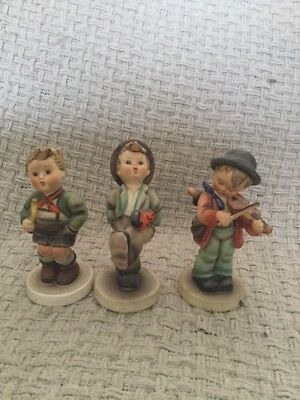 Three Vintage Hummel Goebel Figures Little Fiddler, Trumpet Boy, Umbrella Boy