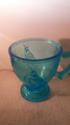 "child's glass blue cup with rabbit 3&3/8"" high"