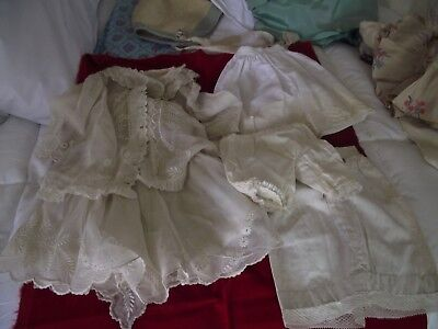 Old doll and baby clothes