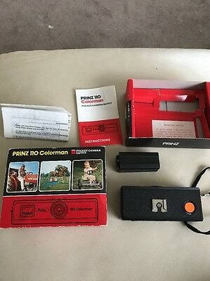 Prinz 110 Colorman pocket camera with flash extender , Wrist strap and manual