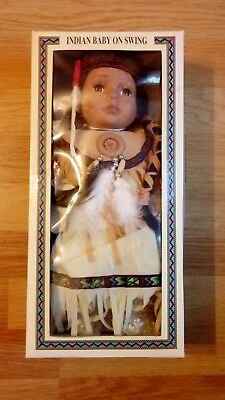 Fine Porcelain Indian doll on a swing