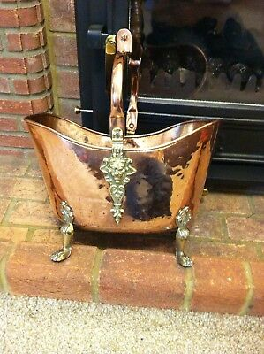 victorian copper and brass coal scuttle with lion motif and 4 feet,woodhandle