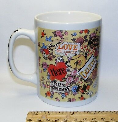 Mary Engelbreit ceramic coffee mug, yellow with ME mottoes and designs