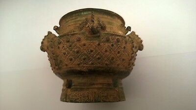 Old bronze vessel with animal motifs