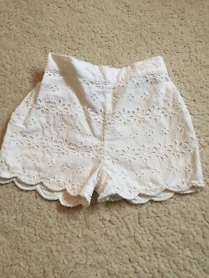 baby girl next white shorts aged 6-9 months
