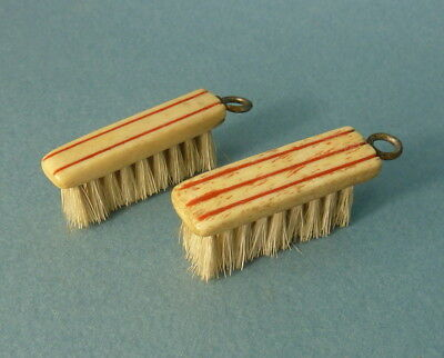 Vintage dolls house clothes brushes.