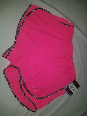 NIKE Dri-fit Womens XL hot pink running shorts with interior lining.