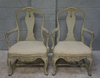 A pair of 20th century Scandinavian grey painted open arm chairs